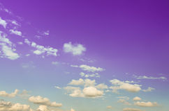 Sky. Colorful purple sky with fluffy clouds Royalty Free Stock Photos