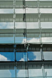 Sky in Columns of Windows. A reflection of blue sky and white clouds in columns of windows Royalty Free Stock Images