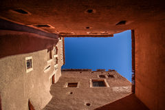 Sky confined by red houses. Insight a moroccan kasbah Stock Image