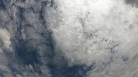 The sky is covered with clouds. High cloudiness, cloudy weather, time-lapse.