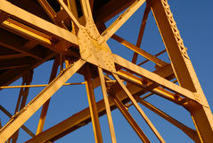 Sky Crane 3. A detail of an old yellow freight crane against a bright blue sky stock photos
