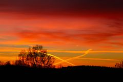 The sky is crossed on a lovely December sunset Stock Photo
