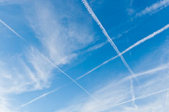 Sky with crossing vapor trails Stock Photography