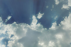 Sky with cumulus clouds and a bright sun Royalty Free Stock Photography