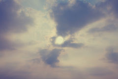 Sky with cumulus clouds and a bright sun closeup Stock Image