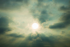 Sky with cumulus clouds and a bright sun closeup Royalty Free Stock Images