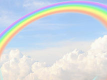 Sky with cumulus clouds and rainbow Royalty Free Stock Image