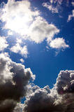 Sky and dark clouds. Dark clouds, sun and blue sky royalty free stock photo