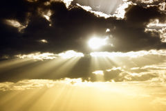 Sky with dark clouds and sun rays. Sky with dark black clouds and light sun rays Stock Photo