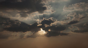Sky with dark clouds and sun rays . Stock Image