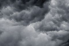 Sky with dark dramatic clouds during a thunderstorm or a hurricane_. Sky with dark dramatic clouds during a thunderstorm or a hurricane stock photo