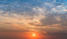 Sky at dawn. The orange and blue sky when the sun is setting Royalty Free Stock Image