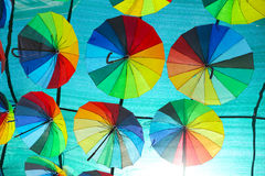 Sky decorated with colored umbrellas Stock Photos