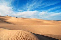 Sky of desert. Dunes shaped by the wind Stock Images