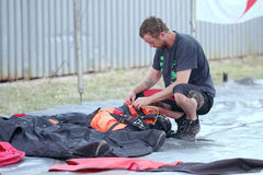 Sky diver packing and checking chute before next jump. RUSTENBURG, SOUTH AFRICA - April 28, 2017: National Skydiving Championships. Skydiver packing and Royalty Free Stock Images