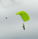 Sky diving tandem parachutists gliding toward landing Stock Photo