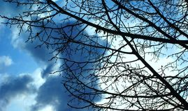 The sky of early spring changes every minute. This inconstancy fascinates Royalty Free Stock Image
