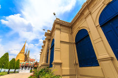 The sky at the Emerald Buddha Temple. The yellow building is the Temple of the Emerald Buddha Royalty Free Stock Photo