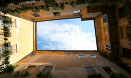 Sky enclosed by the walls of an ancient house in Italy Royalty Free Stock Images