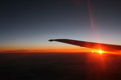 The sky on fire. Sunset view from the aircraft window while flying Royalty Free Stock Photo