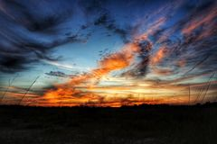 The sky is on fire. Beautiful sunset over a field with Stock Images