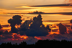 Sky On Fire. Dramatic sunset sky with clouds glowing red Royalty Free Stock Image