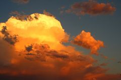Sky on Fire. Flaming red fire in the sky cloudscape background Stock Photo