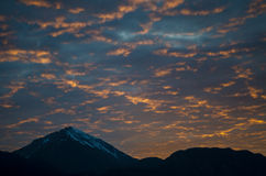 Sky on fire. Fire like cloudscape with mountains in the background Stock Images