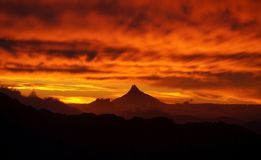 Sky on fire with mordor like volcano at sunset in Nahuel Huapi National Park, Argentina.  Stock Image