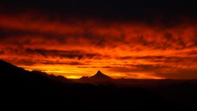 Sky on fire with mordor like volcano at sunset in Nahuel Huapi National Park, Argentina.  Royalty Free Stock Photography