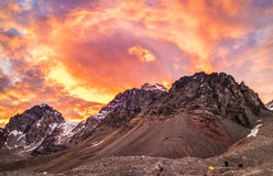 The Sky on Fire at the Mountain Stock Images