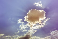 Sky. Flower clouds with sun beam behind Stock Photography