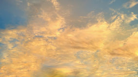 The sky with fluffy clouds and bright yellow sunshine. S Royalty Free Stock Photo