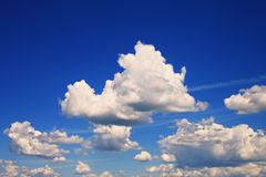 Sky with fluffy cumulus clouds Stock Photos