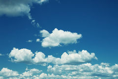 Sky with fluffy cumulus clouds Stock Images