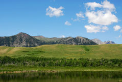 Sky, foothills and lake. Beautiful summer scene of blue sky, foothills and lake in the waterton lakes national park, alberta, canada stock photos