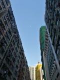 Sky framed. Moon framed by urban buildings Hong Kong stock photos