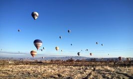 The sky full of colourful hot balloons. Pretty view in turkey ,blue sky full of colourful hot balloons Stock Photography