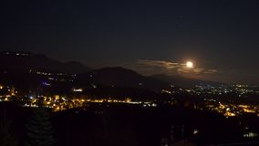The sky with the full moon. The rising of the full moon, in the sky behind the small village of Sordevolo stock video footage