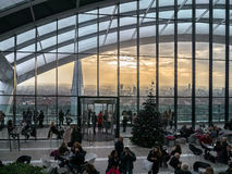 Sky Garden London. A view from within the Sky Pod Bar to the London Skyline as the sun is setting Royalty Free Stock Photo