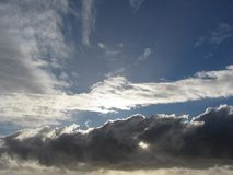 Sky with giants cumulonimbus clouds and sun rays through Royalty Free Stock Photo