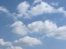 Sky with giants cumulonimbus clouds and sun rays through Stock Image