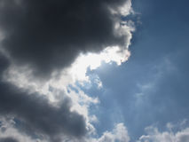 Sky with giants cumulonimbus clouds and sun rays through Stock Images