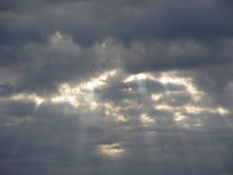 Sky with giants cumulonimbus clouds and sun rays through Royalty Free Stock Images