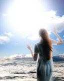 Sky girl. Angel girl in the blue sky see god Royalty Free Stock Images