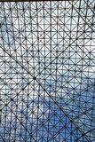 Sky Through Glass Roof. Blue sky and clouds through glass roof royalty free stock images