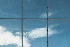 Sky in the glass. The glass wall reflects the sky Royalty Free Stock Photos