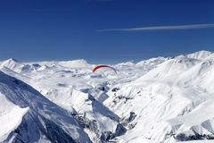 Sky gliding in snowy mountains Royalty Free Stock Photos