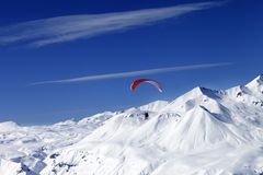 Sky gliding in snowy mountains at nice sun day Stock Photo