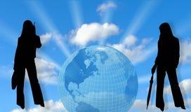 Sky, globe and women Royalty Free Stock Photo